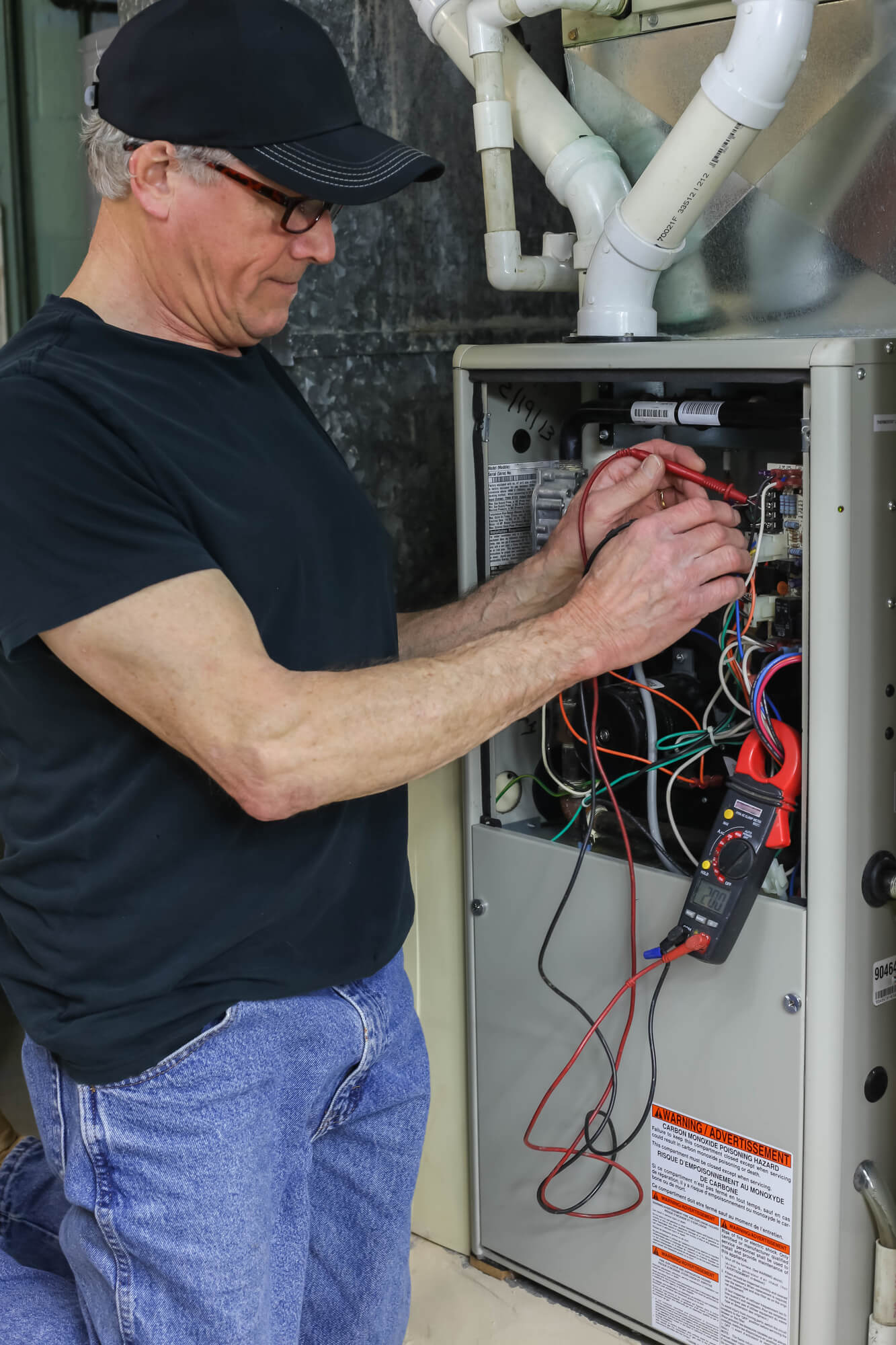 HVAC Technician repairing furnace