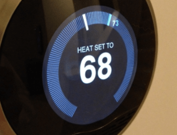 smart thermostat on wall set to 68 degrees