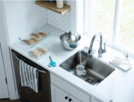 Kitchen sink with an installed garbage disposal unit